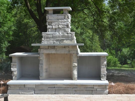 An outdoor fireplace designed by Alabama Landscape