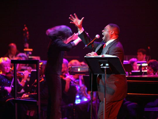 "Tenor Rodrick Dixon and conductor Suzanne Mallare Acton performing ""Too Hot to Hanel"" at the Detroit Opera House"