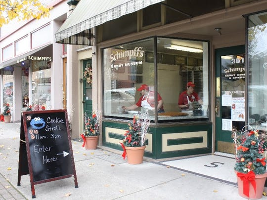 Small businesses welcomed shoppers and offered something for those with a sweet tooth during the Christmas Cookie Stroll in downtown Jeffersonville. Schimpff's Confectionery set out raspberry filled cookies.