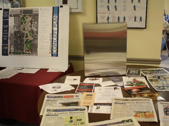 A dedication ceremony for a time capsule to be buried in Corydon's Bicentennial Park included cake, the viewing of items to be included in the time capsule, and plans for the park, was held at the Joe Rhoads Senior Center in Corydon on Friday.