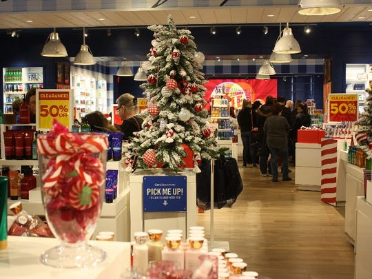 Shoppers hunt for after-Christmas bargains at Green Tree Mall on Monday.  Dec. 26, 2016