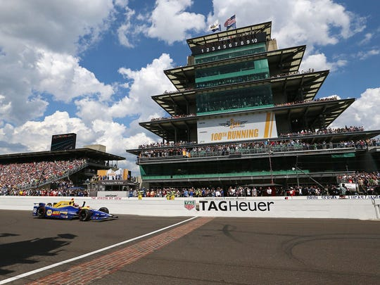 IndyCar driver Alexander Rossi crosses the finish line