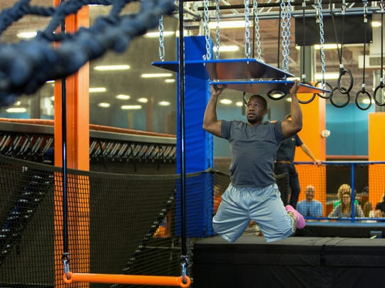 It takes muscle to get through the Warrior Course at Sky Zone.
