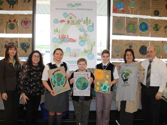 Perth Amboy Mayor Wilda Diaz holds up a ShopRite Earth