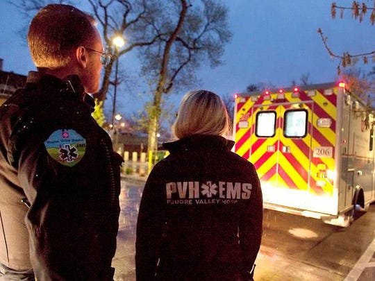 Poudre Valley Hospital EMTs Lt. Darin Johnson and Chelsea Spencer respond to a call on April 28. Johnson has worn body armour for the last decade.