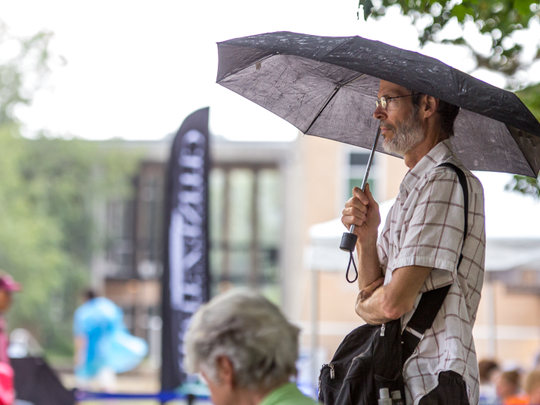 Rain didn't disappoint the concert-goers to a UNC Asheville Concert on the Quad in 2016. The crowd huddled under umbrellas and ponchos to watch the show.