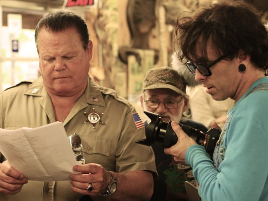 Director Muck Sticky (right) trains his lens on actor