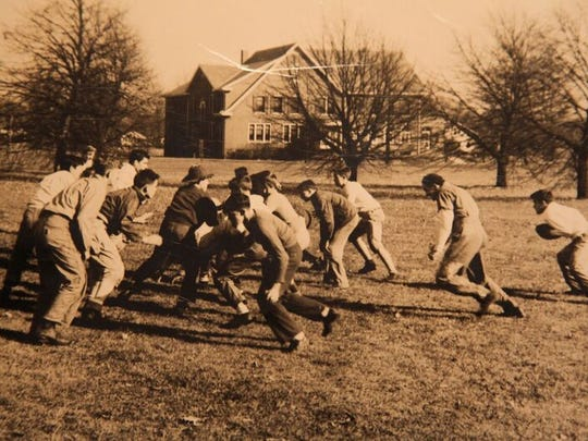 Students participate in a football game.