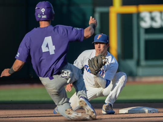 Gators infielder Dalton Guthrie (5) tags TCU Horned Frogs infielder Cam Warner (4) on an attempted steal Sunday.