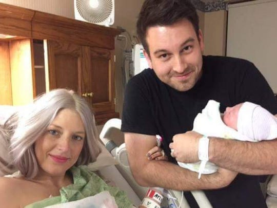 The Johnsons hold their new daughter Eilee before complications