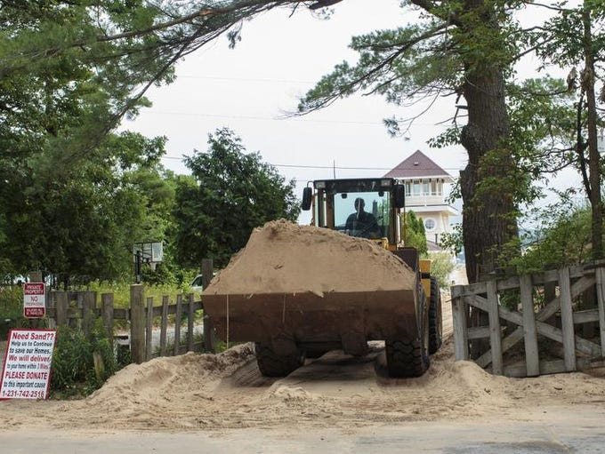 In a  July 13, 2017 photo, sand is removed from the