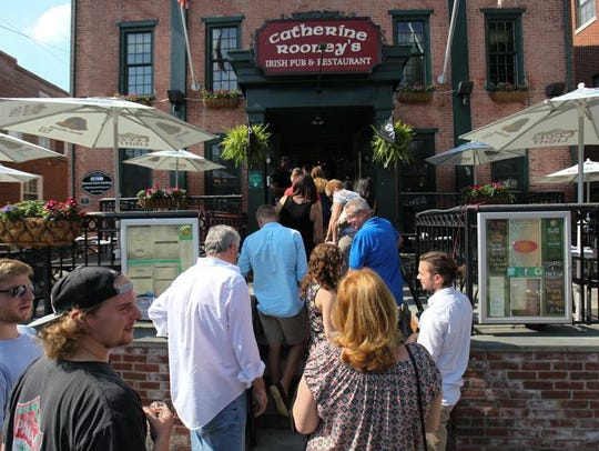 Patrons gather at Catherine Rooney's for a Downtown Newark Food and Brew Fest. The restaurant and bar will be officially re-named Finn McCool's by new owners later this month.