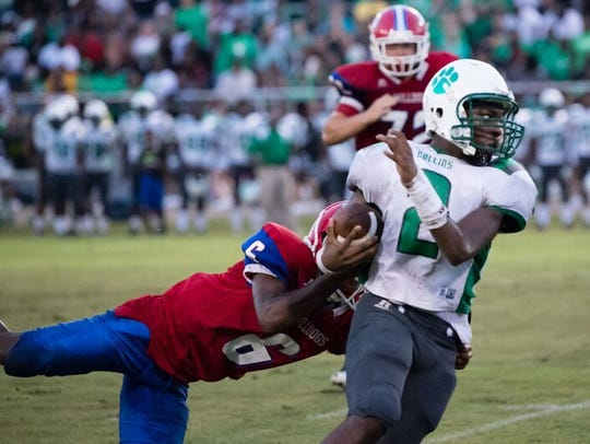 Collins wide receiver Markel McLaurin runs the ball