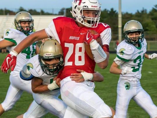 Wisconsin Rapids running back Isaac Pelot carries an