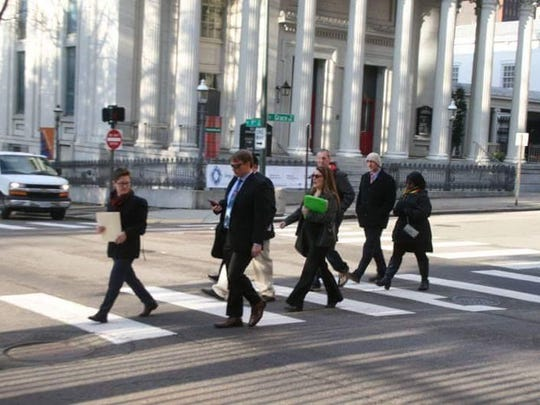 """Staunton Republican and medical marijuana advocate Nikki Narduzzi walks with a group of medical marijuana advocates to the Virginia General Assembly on Virginia NORML lobby day in Richmond. """"One of these fellow advocates, Bryan Wilson, lost his battle to cancer this summer,"""" says Narduzzi."""