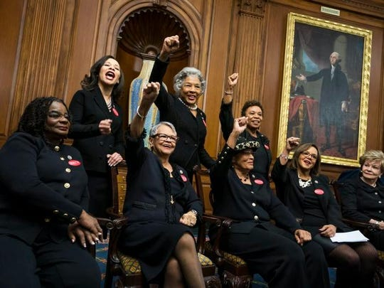 Rep. Lisa Blunt Rochester poses with other Democratic members of the House while wearing the black clothes on Tuesday. They are wearing black in support of the #MeToo movement, along with 'those seeking economic security and a cultural shift that enables men and women to work side by side in safety and dignity, free of sexual harassment, and paid fairly for the value of their work.'