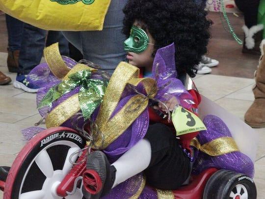 The Krewe of Janus Children's Parade rolls through Pecanland Mall Saturday morning.