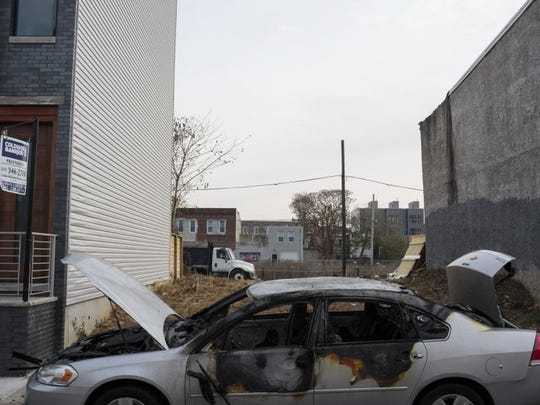 This Nov. 12, 2017, photo provided by Reveal shows Point Breeze neighborhood in Philadelphia. Fifty years after the federal Fair Housing Act banned racial discrimination in lending, African Americans and Latinos continue to be routinely denied conventional mortgage loans at rates far higher than their white counterparts. In Philadelphia, African Americans and non-Hispanic whites make up a similar share of the population there, but the data showed whites received 10 times as many conventional mortgage loans in 2015 and 2016.
