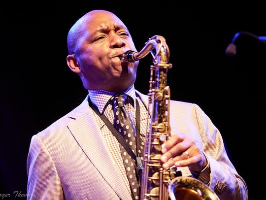 Branford Marsalis fronts the quartet during a performance