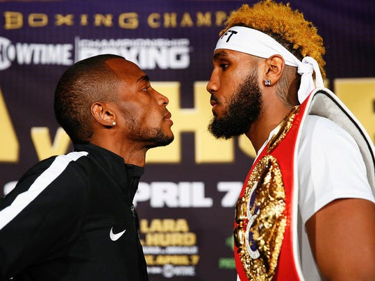 Erislandy Lara, left, and Jarrett Hurd face off after