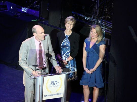 Samuel Reckford, left, accepts the induction in May 2018 of his grandmother, the late Rep. Millicent Fenwick, to the New Jersey Hall of Fame. The presenters are former Gov. Christine Todd Whitman, center, and CNN anchor Susan Hendricks.