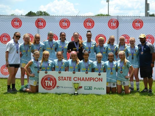 The Murfreesboro Futbol Club U15 Storm squad recently won the Tennessee State Soccer Association state title. Team members include (front row, l-r) Katelyn Seacrist, Kylie Williams, Morgan Simmons, Alison LaLance, Yukino Wakatsuki, Lindsey Bjorklund, Vanessa Martinez, Abbie Smith. Back row (l-r): Coach Taylor Cunningham, Olivia Marlow, Delaney Mitchell, Emily Baker, Ella Riley, Maura Gordon, Dara May, Shannon O'Bryan, Dakota Mitchell, Kyla Hawkins, Lauren Todd, Coach Billy Lewis.