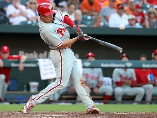 Philadelphia Phillies shortstop Scott Kingery (4) connects