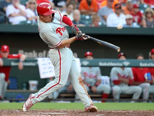 Philadelphia Phillies shortstop Scott Kingery (4) connects for a base hit against the Baltimore Orioles at Oriole Park at Camden Yards.