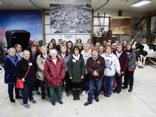 Bus 1 group under the vintage fruit market photo in