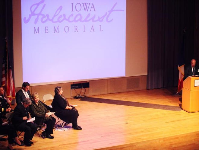 Mark Finkelstein of the Jewish Federation of Greater Des Moines introduces Iowa Gov. Terry Branstad as a speaker at the dedication of the Iowa Holocaust Memorial on Wednesday.