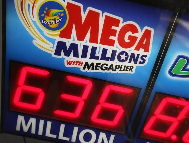 A sign advertising the $636 million Mega Millions lottery jackpot hangs in a convenience store window on December 17, 2013 in Chicago.