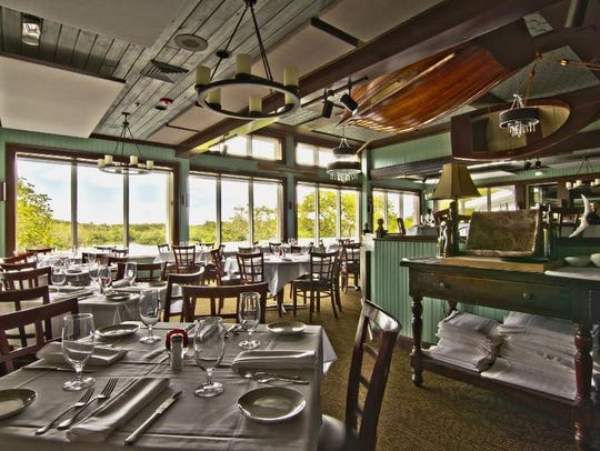 The airy dining room at The Bay House in North Naples