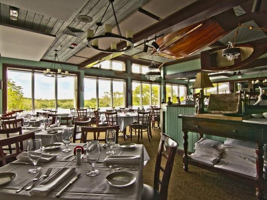 The airy dining room at The Bay House in North Naples looks onto the Cocohatchee River.