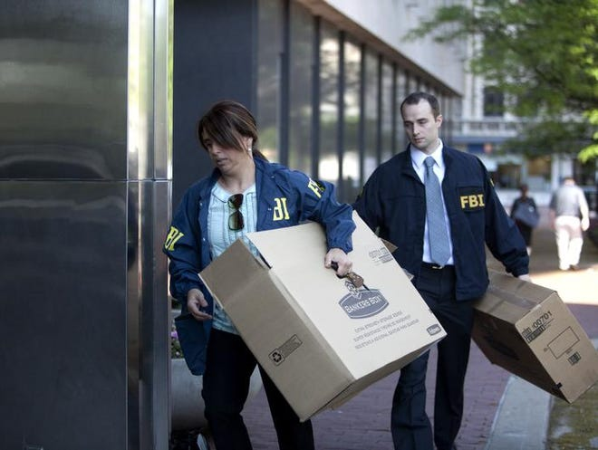FBI agents bring in more boxes to the City-County Building's 20th floor offices of the Indianapolis Department of Metropolitan Development on May 21, 2013, in a raid aimed at gathering Indy Land Bank files and documents.
