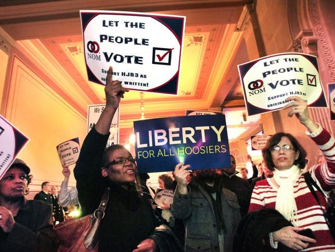 Demonstrators from both sides of the HJR-3 issue shout and sing Feb. 13, 2014, outside the Indiana Senate chamber at the Statehouse in Indianapolis.