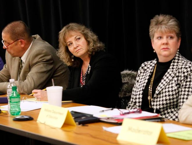 Glenda Ritz, center, the Indiana Superintendent of Public Instruction, is joined by State Board of Education members Troy Albert, left, and Michelle Walker, right, as they listen to community members and educators during the first of three regional public hearings on the future K-12 academic standards.  Feb. 24, 2014