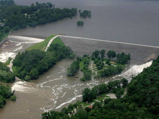 Floodwaters from the Iowa River flow over the emergency spillway and through the Devonian Fossil Gorge, flooding the Tailwater West campground at Coralville Lake on June 11, 2008.