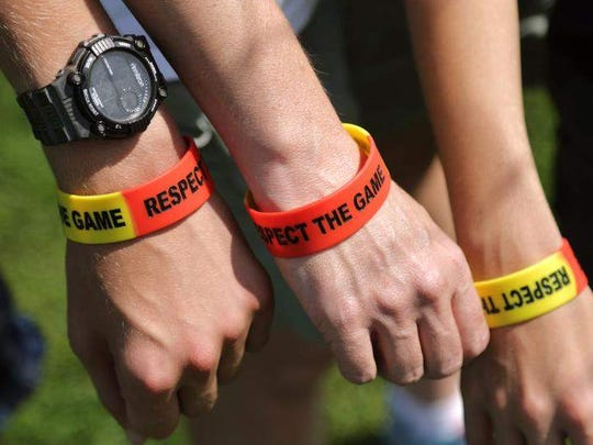 About 750 red-and-yellow bracelets that read 'RESPECT
