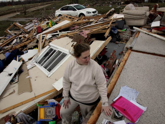 Danya Cox goes through the wreckage of her house on Tuck Road in an area hit hard by a tornado the day before, Feb. 6 2008, in Lafayette, Tennessee.