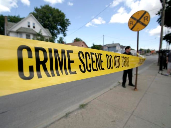 Police put up yellow crime scene tape after an attempted robbery and shooting incident on Lyell Avenue.  ANNETTE LEIN/ STAFF PHOTOGRAPHER Police take down the yellow tape after an attempted robbery and shooting happened on Lyell Ave. earlier this month. For violence story. (staff photo by Annette Lein)