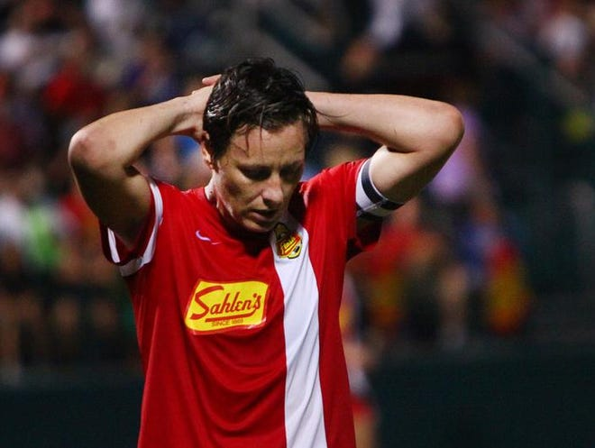 "Western New York Flash forward Abby Wambach shows the frustration of coming up short in Saturday's NWSL title game. ""We're devastated by not being able to pull it out, but I think the result was deserving,"" she said.."
