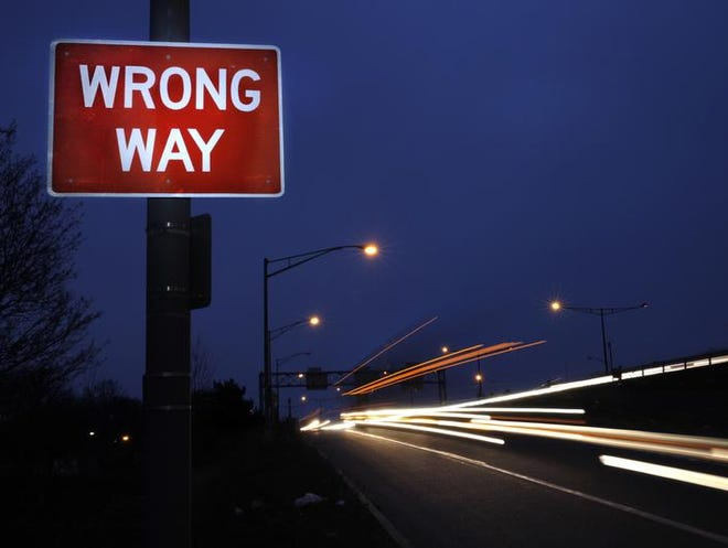 A Wrong Way sign is shown on the exit ramp from 490 west onto Mt. Read Boulevard, where a driver entered 490 going the wrong way killing an oncoming motorist.