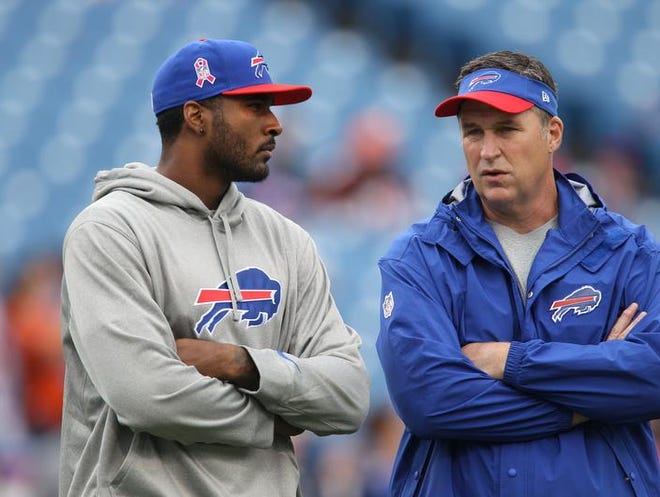 Buffalo Bills quarterback EJ Manuel, left, chats withwith head coach Doug Marrone before the Oct. 13 game against Cincinnati. Manuel missed six games due to injury this season.