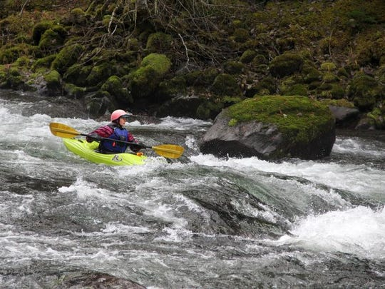 Laurie Pavey runs Ricochet Rapid, a Class IV boulder garden on the upper stretch of the North Santiam River above Detroit Lake.