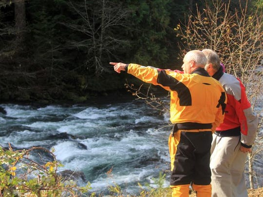 Gerald Orr and Stephen Duff scout Ricochet Rapid, a Class IV boulder garden on the upper stretch of the North Santiam River above Detroit Lake.