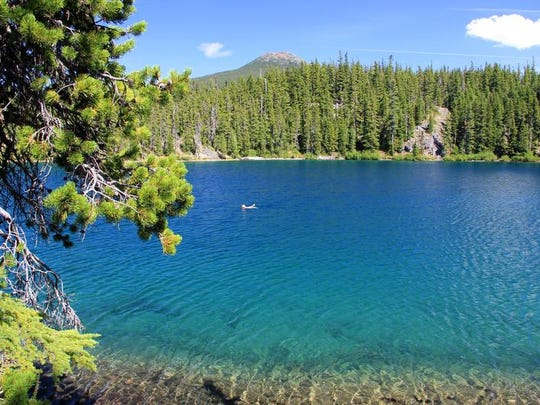 Michael Donnelly takes a swim in the crystal clear waters of Gifford Lake in the Ollalie Lake Scenic Area.