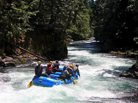A group of rafters float down the White Salmon River.