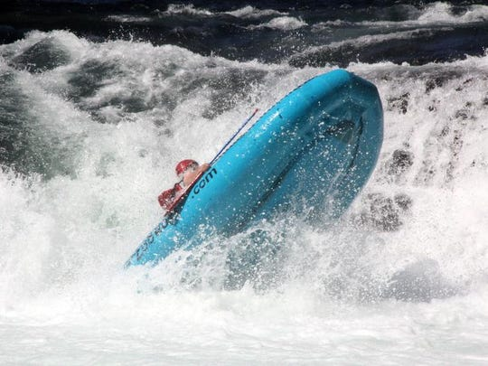 A raft pops up after running Husum Falls on the White Salmon River.