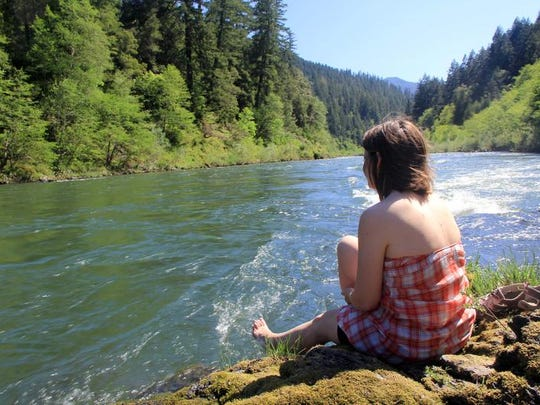 The Rogue River Trail offers many places to relax and put your feet into the river.