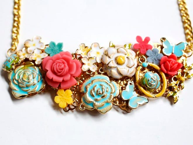A bib necklace uses craft-store charms enameled by Carly J. Cais, who blogs about her DIY fashion style at Chic Steals.